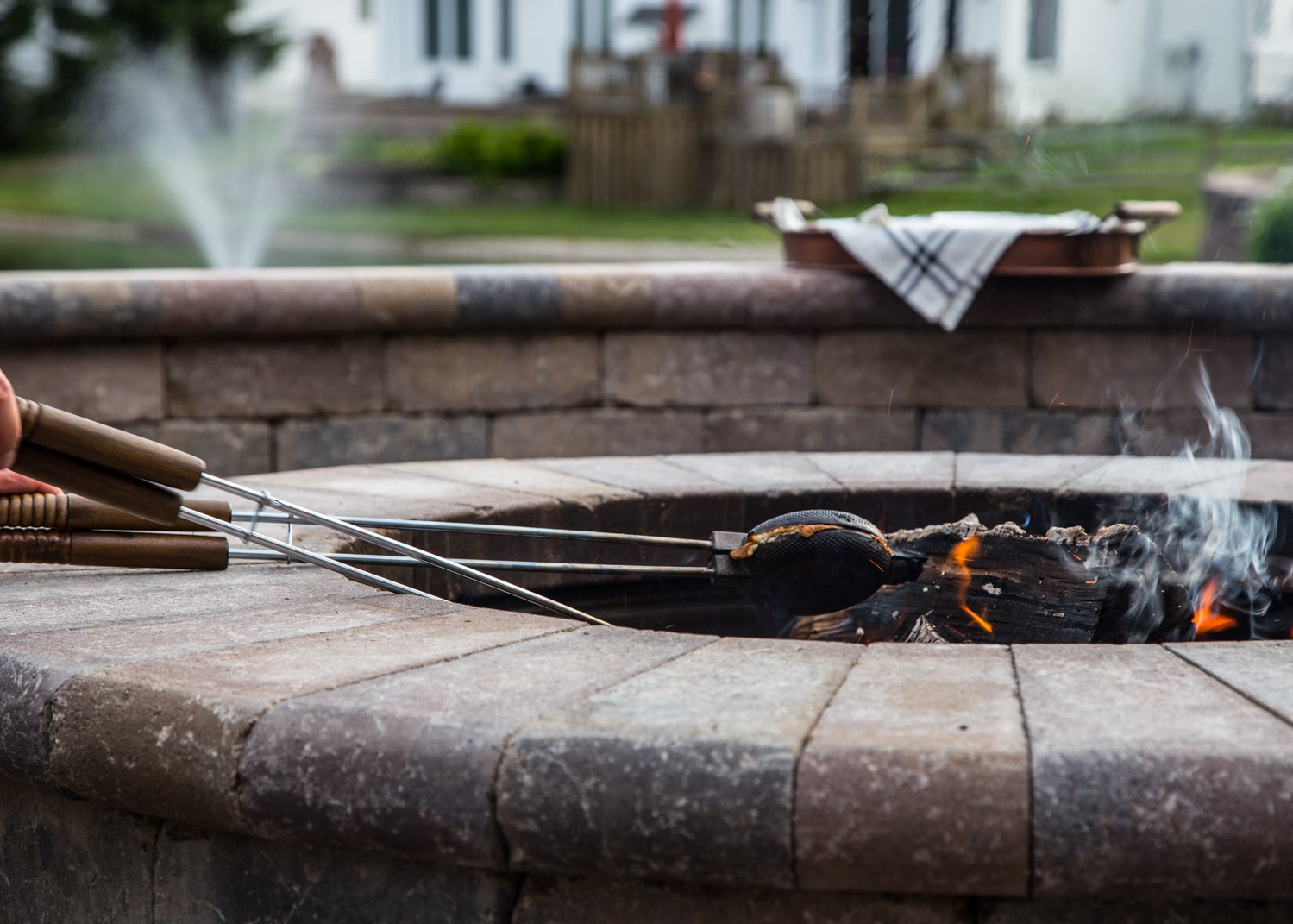 pie irons cooking sandwiches in a fire pit