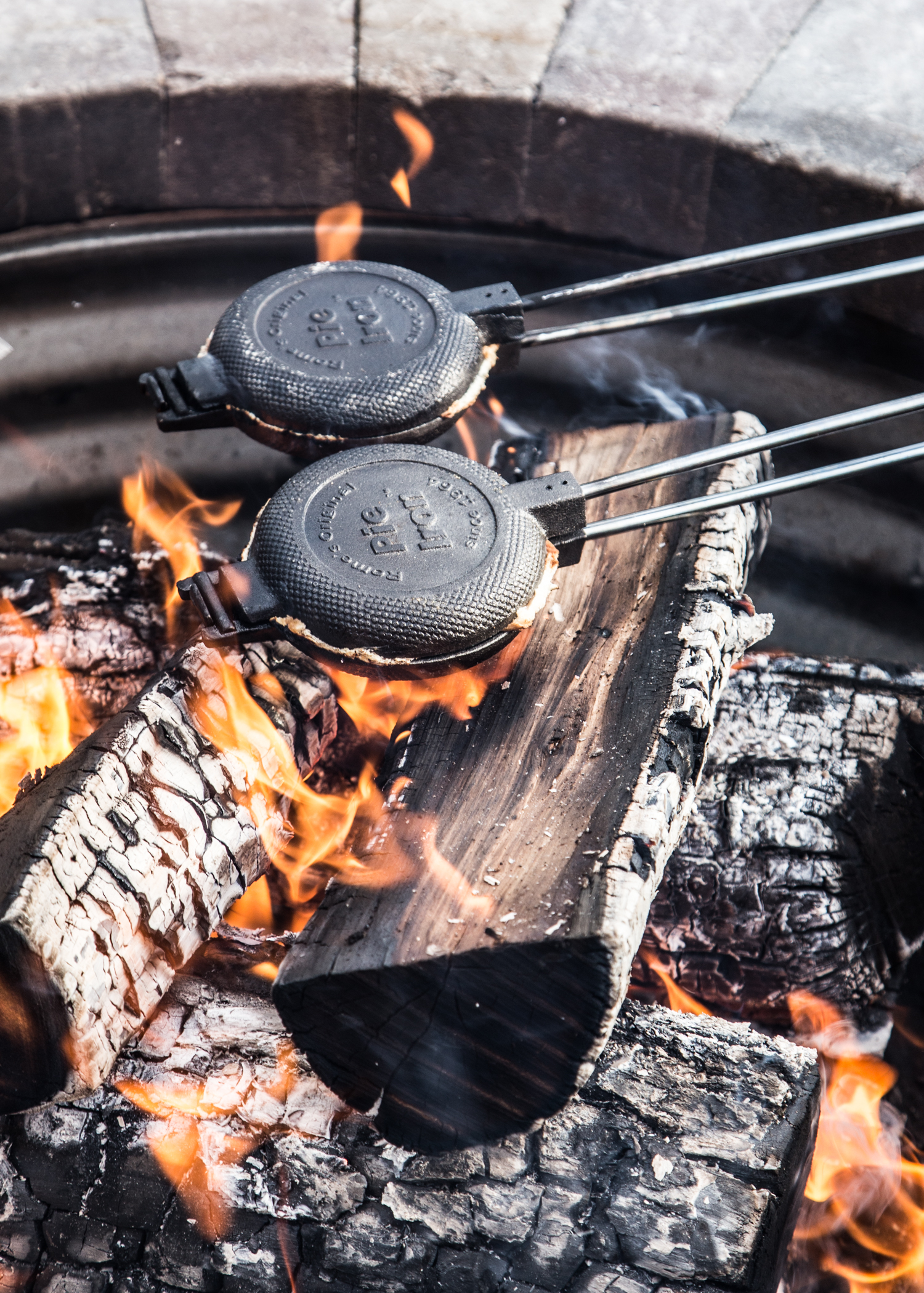 pie irons grilling paninis over a fire